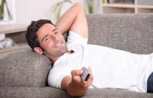 man-listening-to-music-through-tv