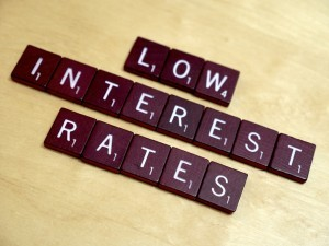 The words low interest rates written using scrabble letters