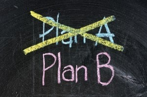 Plan A crossed out on a blackboard with Plan B visible