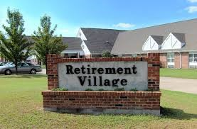 Retirement Village written on a sign outside retirement home