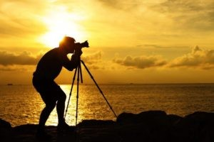 Man photographing a beautiful senset