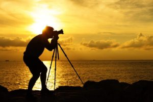 Man photographing a beautiful senset