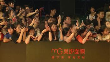 Chinese movie fans taking photos of movie star on mobile phones