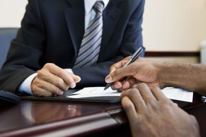 Man signing business loan papers