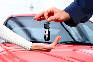 Dealer handing car keys over